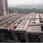 Eldőlt egy 13 emeletes társasház Kínában