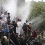KARACHI, PAKISTAN - JUNE 24: Pakistani people cool off at water supply pipelines during a heatwave in Karachi, Pakistan on June 24, 2015. More than 1,000 people have been killed over five days by a searing heatwave in Pakistan, with the worst effects in the country's commercial capital Karachi. (Photo by Sabir Mazhar/Anadolu Agency/Getty Images)