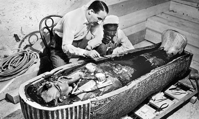 Howard Carter examines the sarcophagus of Tutankhamun