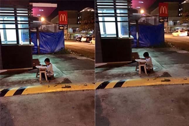 Hajléktalan kisfiú a gyorsétterem fényeinél tanul